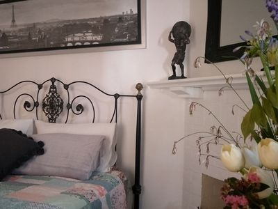 A beautiful room with a cast iron queen bed, pure luxury