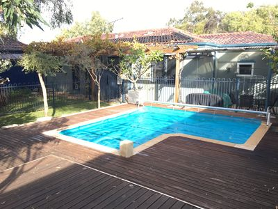 Solar heated pool in back garden