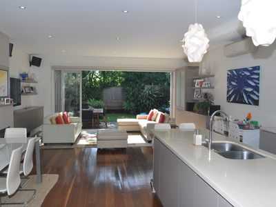 Open plan kitchen and dining looking onto lush private garden