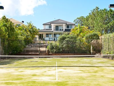 Private full sized tennis court
