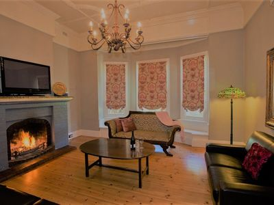 Enjoy relaxing around the wood fire in your lounge room with friends