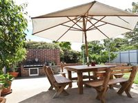 Back yard with BBQ and outdoor dining space