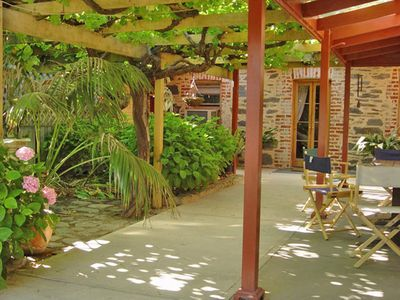 Relax under the 100 year old vines with barbecue