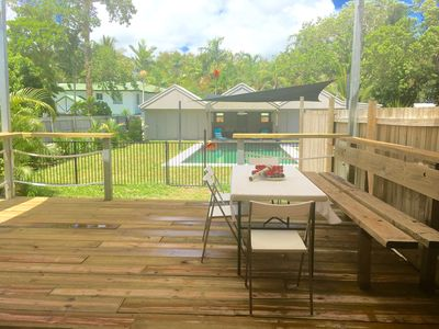 private deck with bbq and pool access