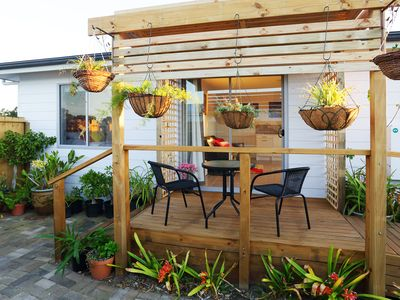 Private courtyard and deck featuring outdoor setting