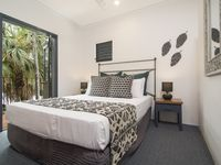 This bedroom has a queen bed, and it's own small balcony