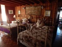 Another bedroom with two double beds.