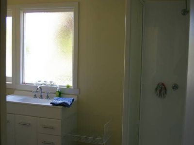 Clean functional bathroom with shower