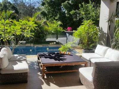 Great alfresco area over looking pool and tropical garden