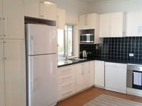Fully equipped kitchen for self-contained accommodation at Beachside Byron