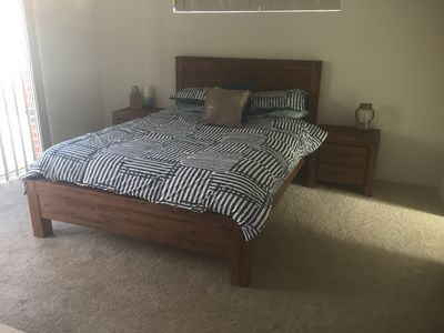 The master bedroom with a comfortable queen size bed and spacious walk in robe.