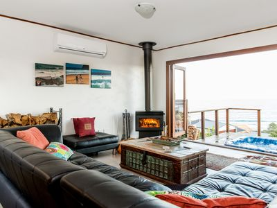Open Living Area with Aircon and Fireplace