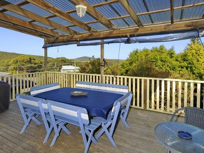spacious front deck with views to the beach and ocean
