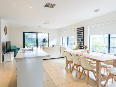 Modern spacious kitchen, meals, family room overlooking garden