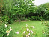 Manicured lawns and hedges, even a fishpond - perfect for lazy afternoons