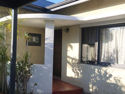 Private entrance from covered carport