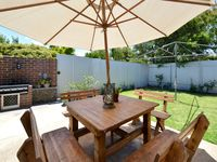back yard with BBQ and 8 seater outdoor setting