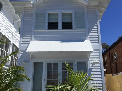 Exterior of two storey beach cottage.