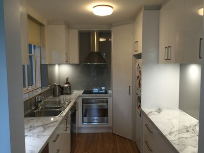 Fully equipped kitchen with microwave, dishwasher and small appliances