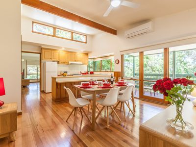 The high ceiling kitchen/dining room is spacious, light, bright and colourful