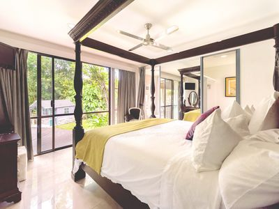 Master Bedroom Overlooking Pool and Playhouse
