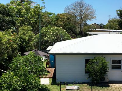 The cottage is surrounded by banksias and fruit trees