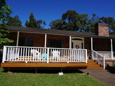 Front of Magnolia house with deck facing garden and Cambewarra Mountain range
