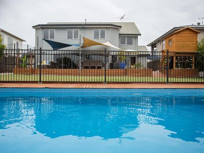 Pool, deck, cubby house and backyard