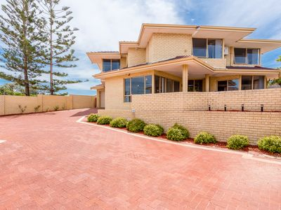 Double storey beachfront property in old Halls Head