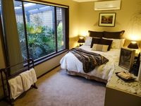 Luxurious Bedroom with secluded garden view