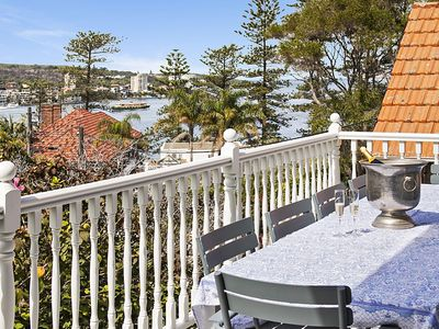 Outdoor dining with harbour view