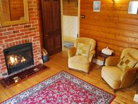 Kelly House - Lounge with wood fire