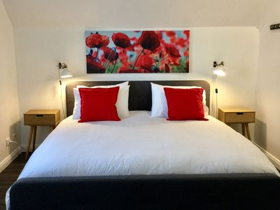 The Loft @ Denver has a king size-bed with hotel quality linens and quilt