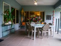 Covered Lanai with outdoor dining, sitting.