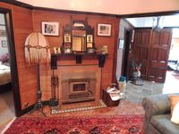 The lounge room with log fire