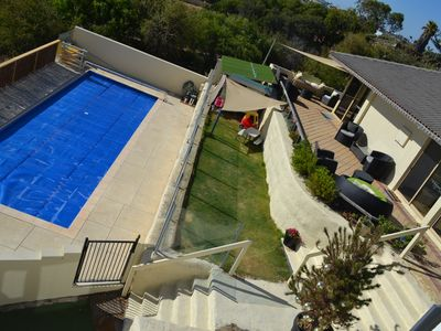 Front view of Beach House Pool compliant - Cubby House on grassed area