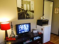 Relaxing Lounge Area with TV, DVD Player and a selection of DVD for your viewing