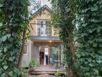 The charming Pool House has two balconies overlooking the ornamental dam.