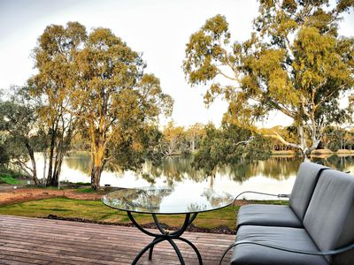 Take in the tranquility of the Murray River from the outdoor lounge on the deck