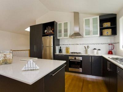 Fully equipped kitchen with dishwasher, microwave and dining table for 6