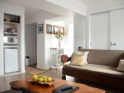 Bright and cosy living area with Balinese daybed sofa and Huon Pine coffee table