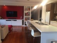 Family & kitchen area with leather chaise sofa and 55