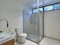 Modern bathroom with large shower and complimentary toiletries