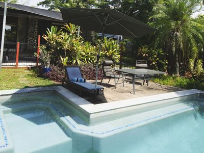 Front Pool Entertainment area with tropical garden and lawn