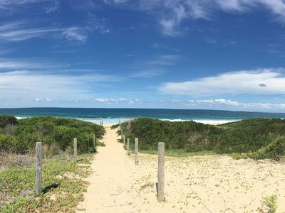 Walk across the sand dunes and you are on the beach