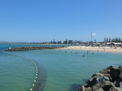 Short walk to Tuncurry rockpool, BBQ area, cafe, breakwall and beach.