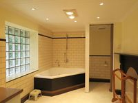 Corner spa, separate toilet and laundry facilities in main bathroom