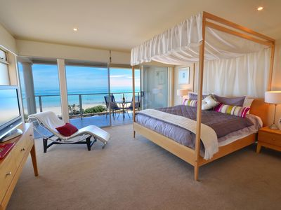King bedroom with views to sandy Henley Beach