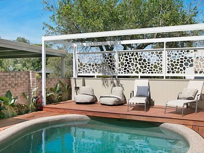 Take a dip, relax on the sun lounges and cushions.