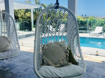 Two blissful hanging chairs. Perfect for watching kids in the pool.